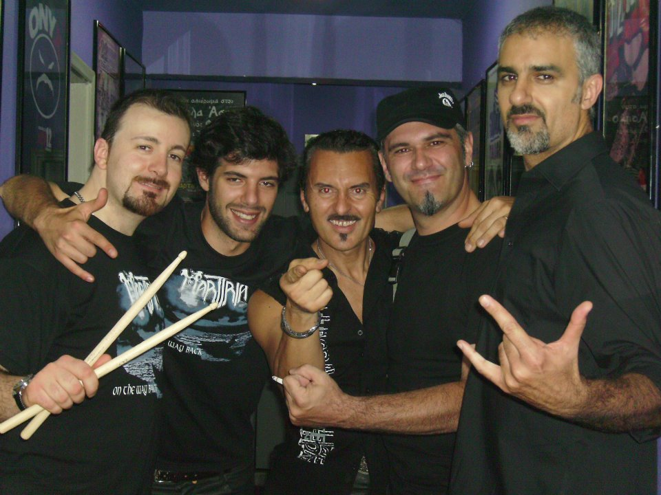 Umberto Spiniello (left) and Andy Menario (right) and Freddy (center) with fans in Athens Greece